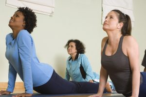 Women stretching their backs in a class