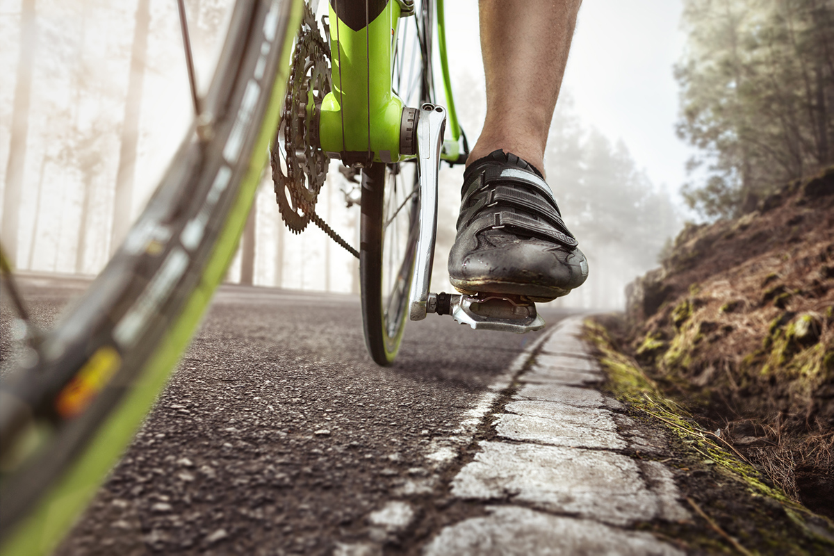 Closeup of foot and pedal on a bicycle
